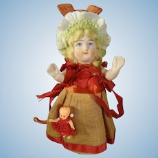 """4 1/2"""" All Bisque Bonnet Head Doll with Her Baby Doll"""