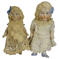 Pair of All Bisque Dolls with Blue Bows in Hair