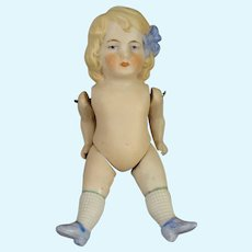 """5"""" All Bisque Doll with Blue Sculpted Bow in Hair"""