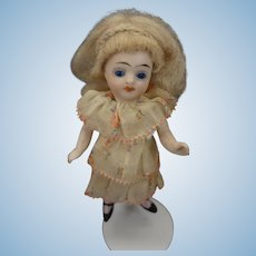 """4"""" All Bisque Doll with Swivel Head and Pink Socks"""