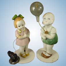 Pair All Bisque Dolls with Dog and Balloon