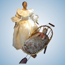 Papier Mache Child in Wicker Carriage