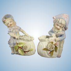 Pair of French Porcelain Children Holding Baskets