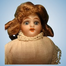 "5"" Bisque Doll with Glass Eyes"