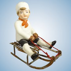 Bisque Boy on Sled