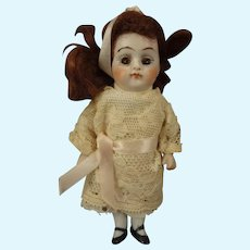 "Lovely 4 1/2"" All Bisque Doll with Sleep Eyes"