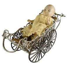 Antique Soft Metal Carriage and Baby Doll