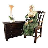 Papier Mache Seated Elderly Lady