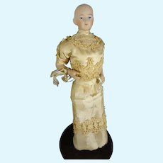 "9 1/2"" Bisque Solid Dome Doll with Bent Arms and Gold Boots"