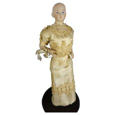 """9 1/2"""" Bisque Solid Dome Doll with Bent Arms and Gold Boots"""