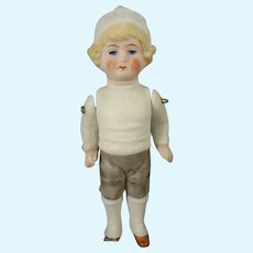 """4"""" All Bisque Doll with Molded Clothes"""