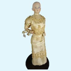"""6 1/2"""" Bisque Solid Dome Doll with Bent Arms and Gold Boots"""