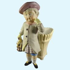 Bisque Figure of Young Lad with Basket