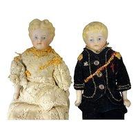 "Pair 9"" Parian Girl and Boy Dolls"