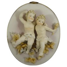 Pair of Porcelain Plaques with Cherubs