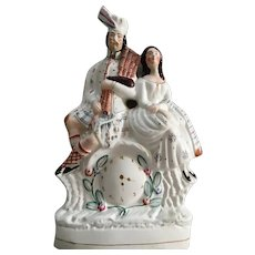 Circa 1860s Antique Staffordshire couple clock figurine