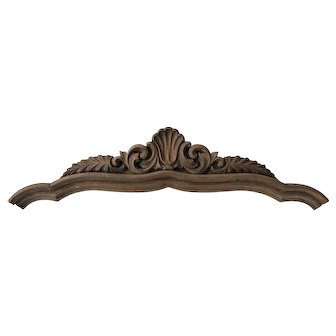 Deeply carved oak pediment