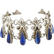Mexican Deco silver repousse Bracelet ~ Taxco fleur-de-lis links with azur blue art glass teardrops