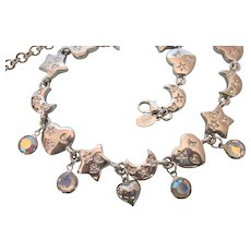 Signed Kirks Folly Stars, Moon and Hearts and Starts Silvertone Necklace With Rhinestones and AB Bezel Dangles