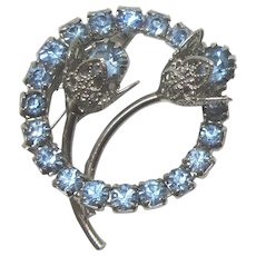 Dazzling Vintage Blue Rhinestone Circle Silvertone Pin With Flowers