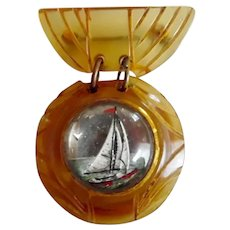 1930's Apple Juice Bakelite Reverse Carved Nautical Pin
