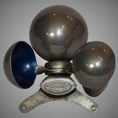 Wiggler Co. Buffalo NY Spinning Rotoscope Automotive Hood Ornament