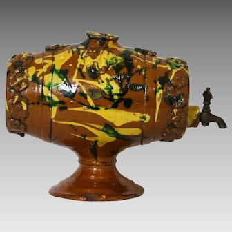 Early 20th Century Redware Keg on Stand with Applied Yellow and Green Slip Decoration