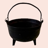 "Antique 9"" Cast Iron Pot with Three Legs and Rat Tail Handle"