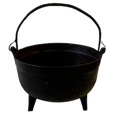 """Antique 9"""" Cast Iron Pot with Three Legs and Rat Tail Handle"""