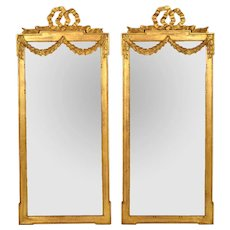 Vintage Pair of Italian Carved Gilt Wood Mirrors with Bow and Swag Motifs