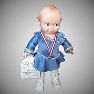"""Large 1983 Kewpie Cameo Doll by Jesco - """"Kewpie Goes Ice Skating""""  w/gold medal"""