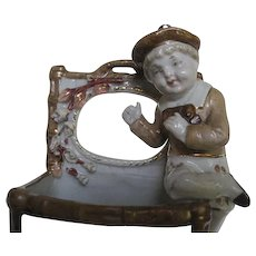 Early 1900's Porcelain Match holder w/Young Boy sitting on basket - made in England