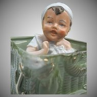 Rare German Porcelain Bisque Infant Boy sitting in Green Wicker Basket - Early 1900's