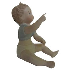 Baby boy pointing up, saying Oohhh - Laszlo Ispansky Porcelain/Bisque Figurine - signed