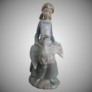 Lovely Lladro Nao Figurine Girl with Pigtails holding a Goose with Wings Spread