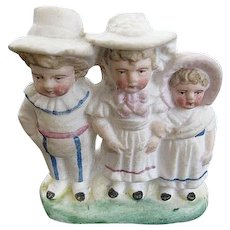 German Bisque small figurine of Three children - One Boy - Two Girls - artist initials