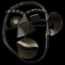 Modernist pin