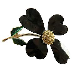 Black enameled flower pin