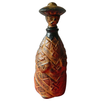 Hand tooled leather wrapped wine decanter