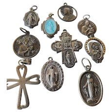 Ten silver religious charms-pendants