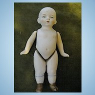 German All Bisque Jointed Child With Painted Eyes