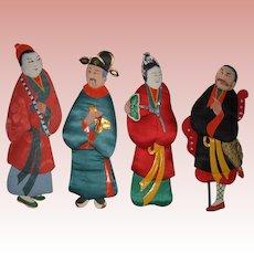 Four Vintage Japanese Paper-Fabric Dolls