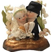 Bisque Kewpie Wedding Cake Topper