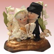 Bisque Kewpie Wedding Cake Topper