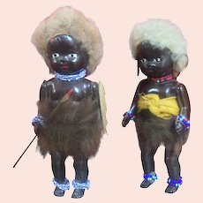 Pair of Hard Plastic African Natives