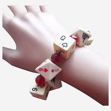 Unusual expanding bracelet dice pieces orange celluloid