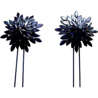 Two late Victorian French jet mourning hair combs or hairpins with star motif