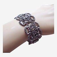 Mid Victorian bracelet in cut steel work open work motifs