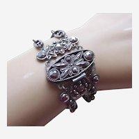 Mid Victorian cuff bracelet in cut steel with open work motifs