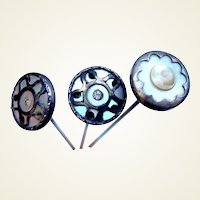 Three late Victorian mother of pearl hat pins